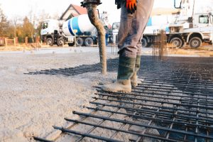 Concrete worker laying a foundation for a business in Concord